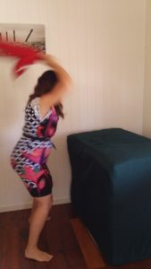 Dealing with the aftermath of domestic violence - hitting the foam cube to release tension in the body - Sarah Tuckett Psychotherapy and Counselling, North Brisbane
