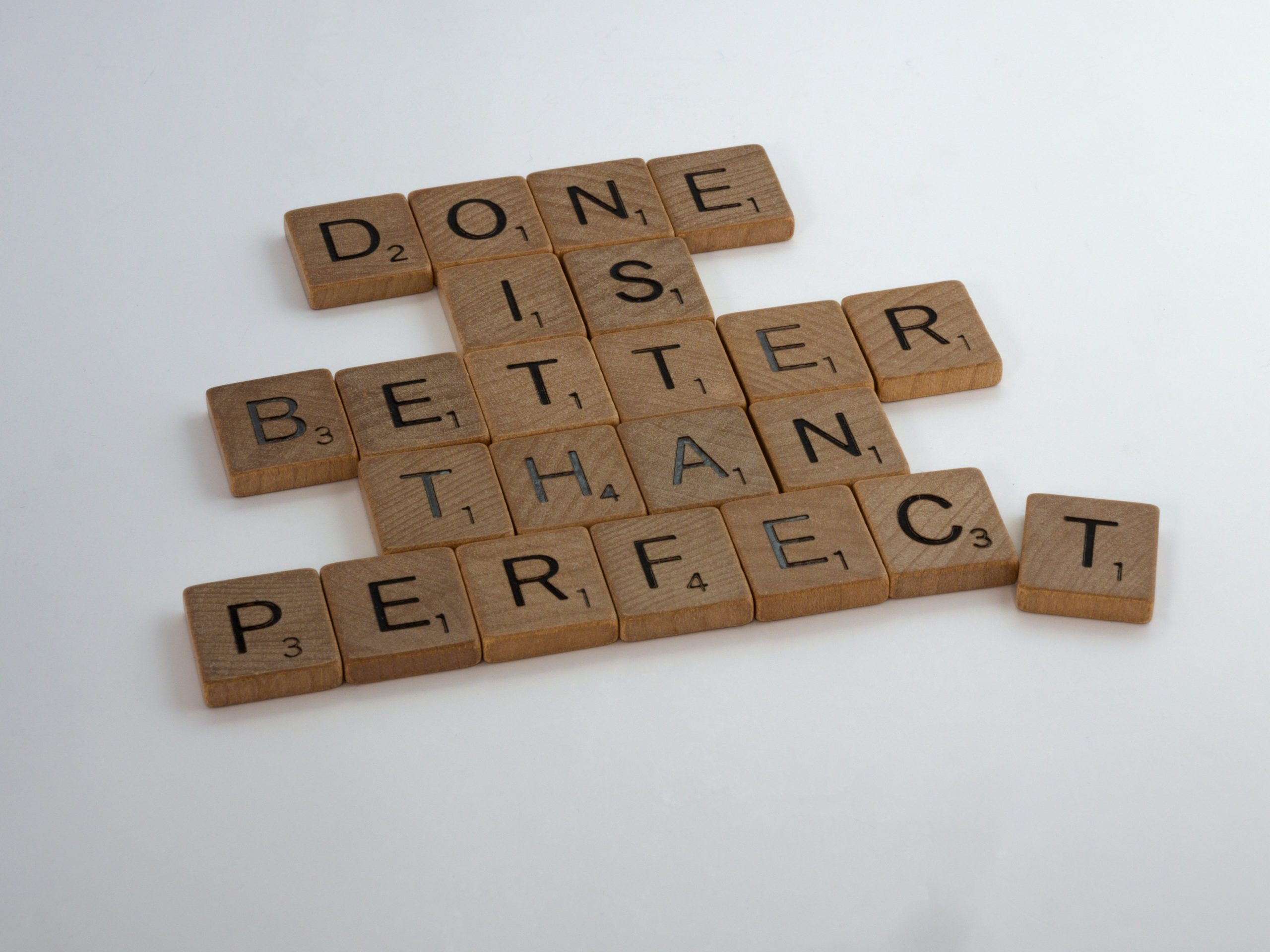 "Scrabble tiles spelling out ""Done is better than perfect"". Learn how to work with your perfectionism with Sarah Tuckett Psychotherapy and Counselling North Brisbane"