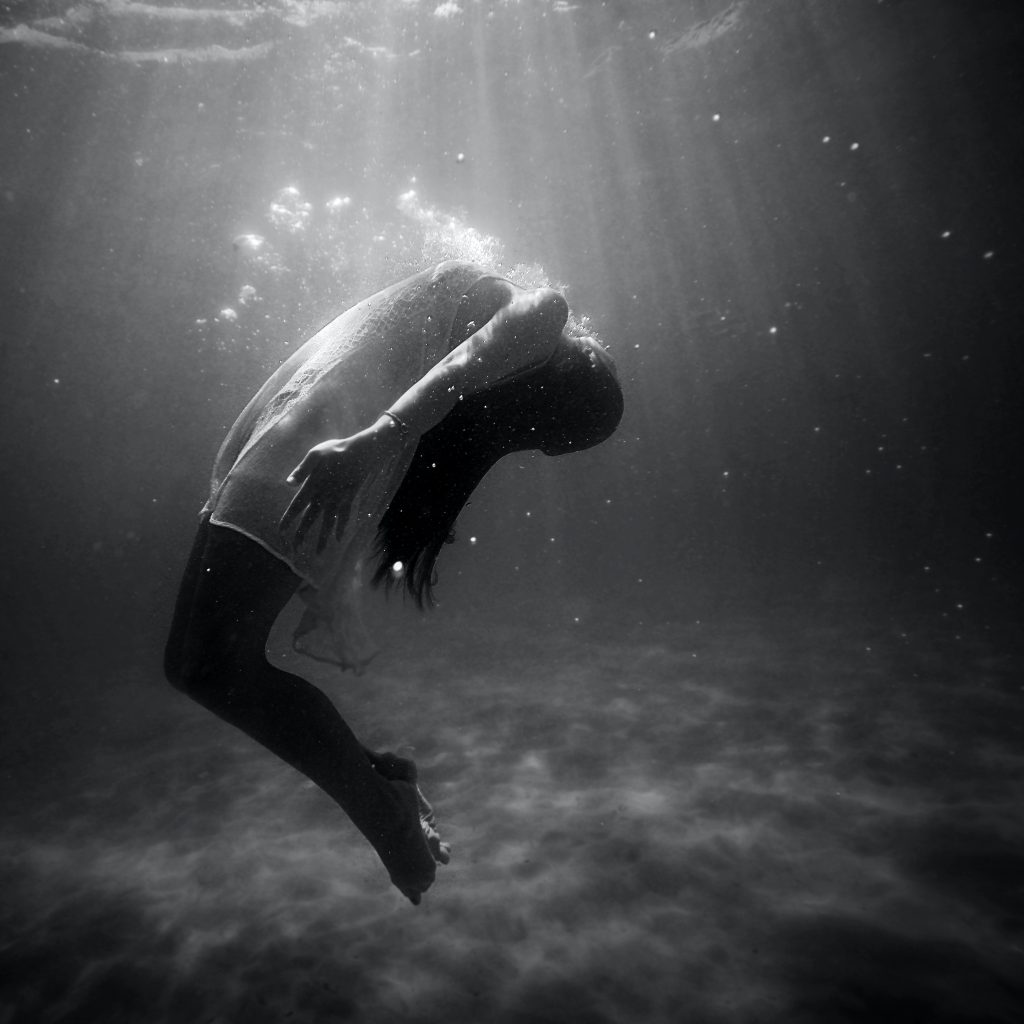 "Woman breathing underwater - Understand ""why do I feel like I am drowning when I have anxiety?"" with Sarah Tuckett Psychotherapy and Counselling North Brisbane"